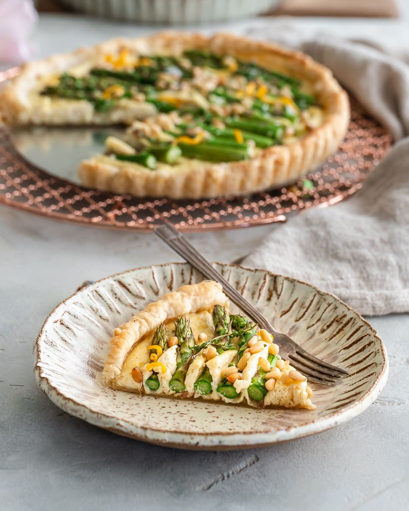 Slice of Puff Pastry Asparagus Tart on a plate