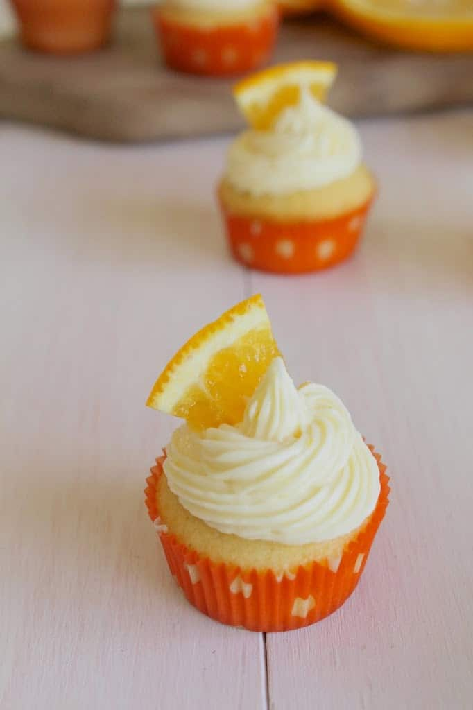 Orange Creamsicle Cupcakes topped with a swirl of orange buttercream