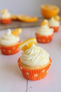 Orange Creamsicle Cupcakes on a white rustic table