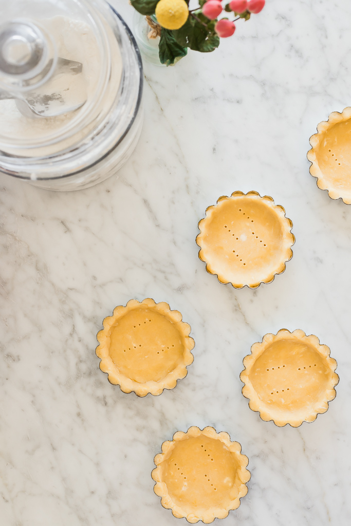 mini tart shells on a marble countertop