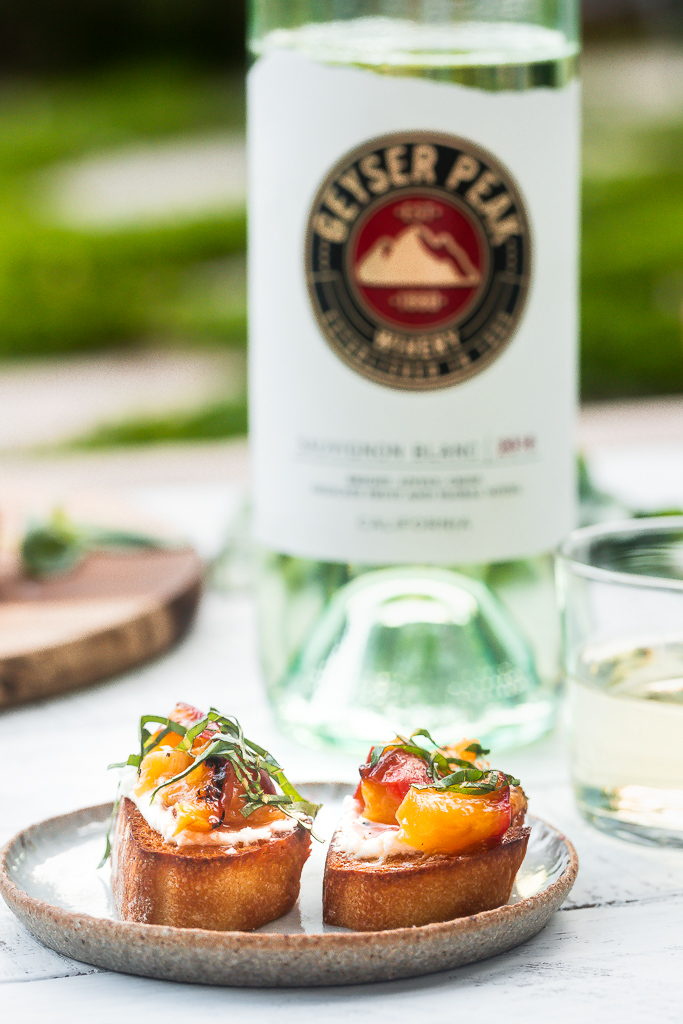 grilled peaches on toast with basil and goat cheese