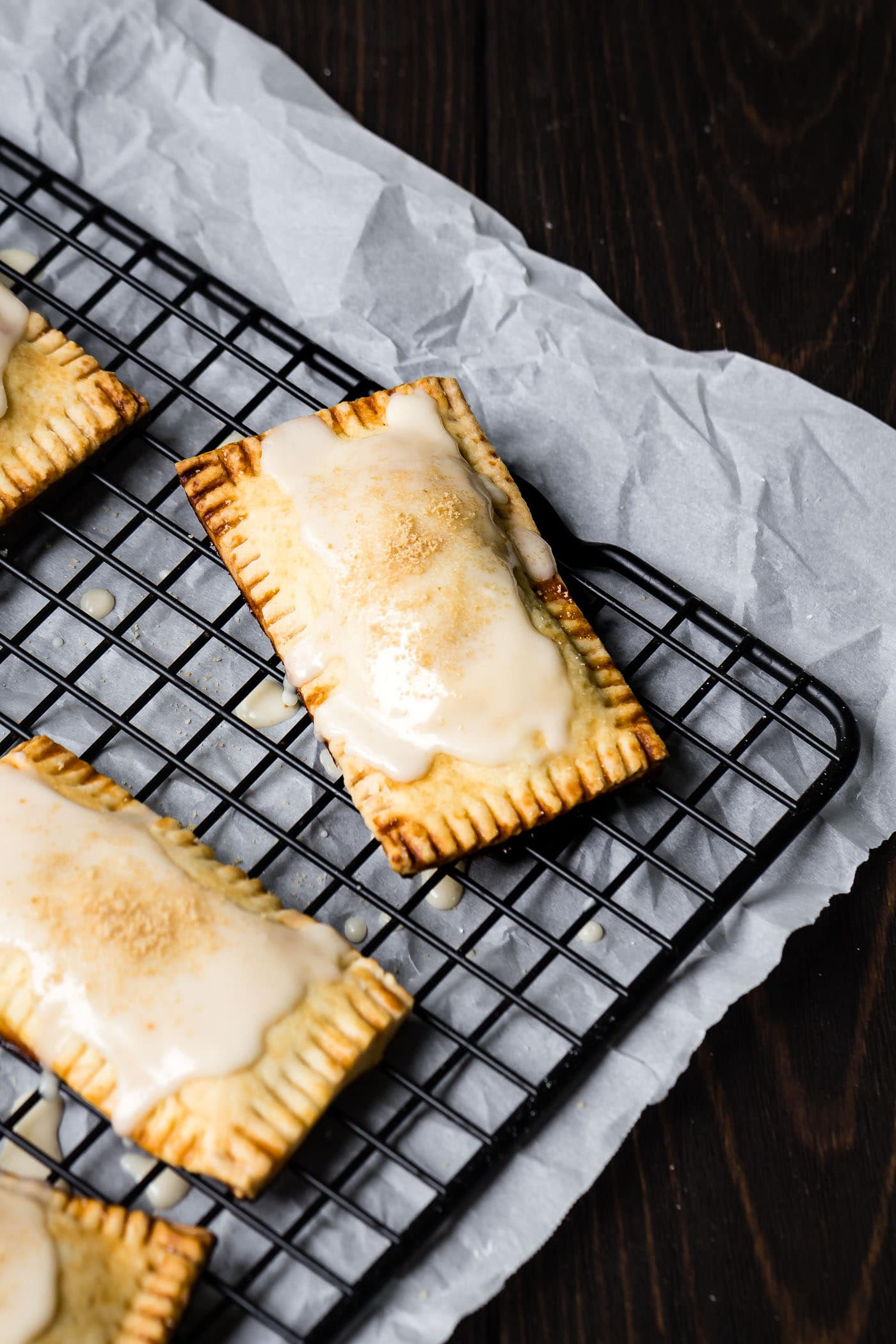 freshly glazed vegan maple pumpkin pop tarts on a cooling rack