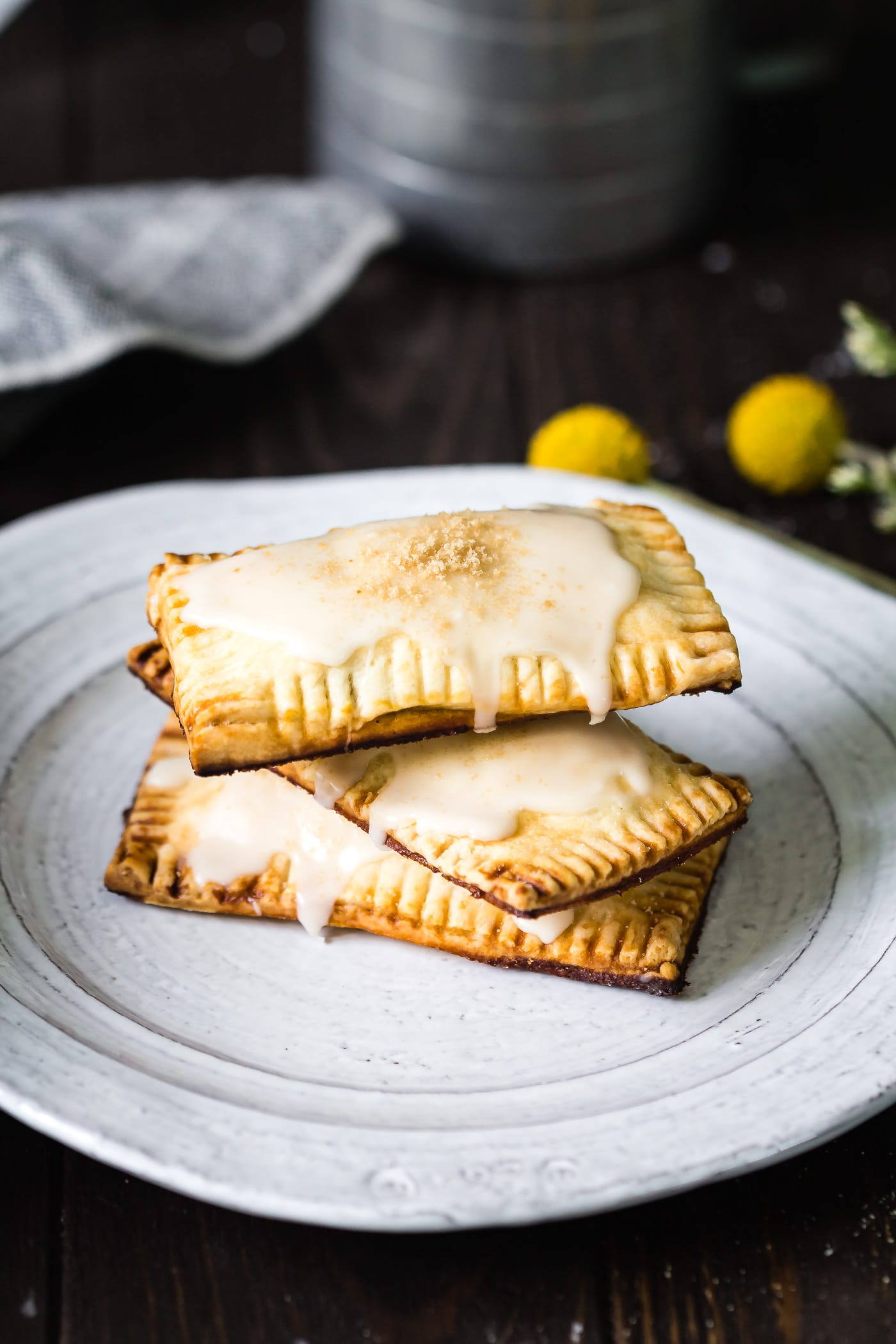 three vegan maple pumpkin pop tarts stacked on top of each other on a white plate