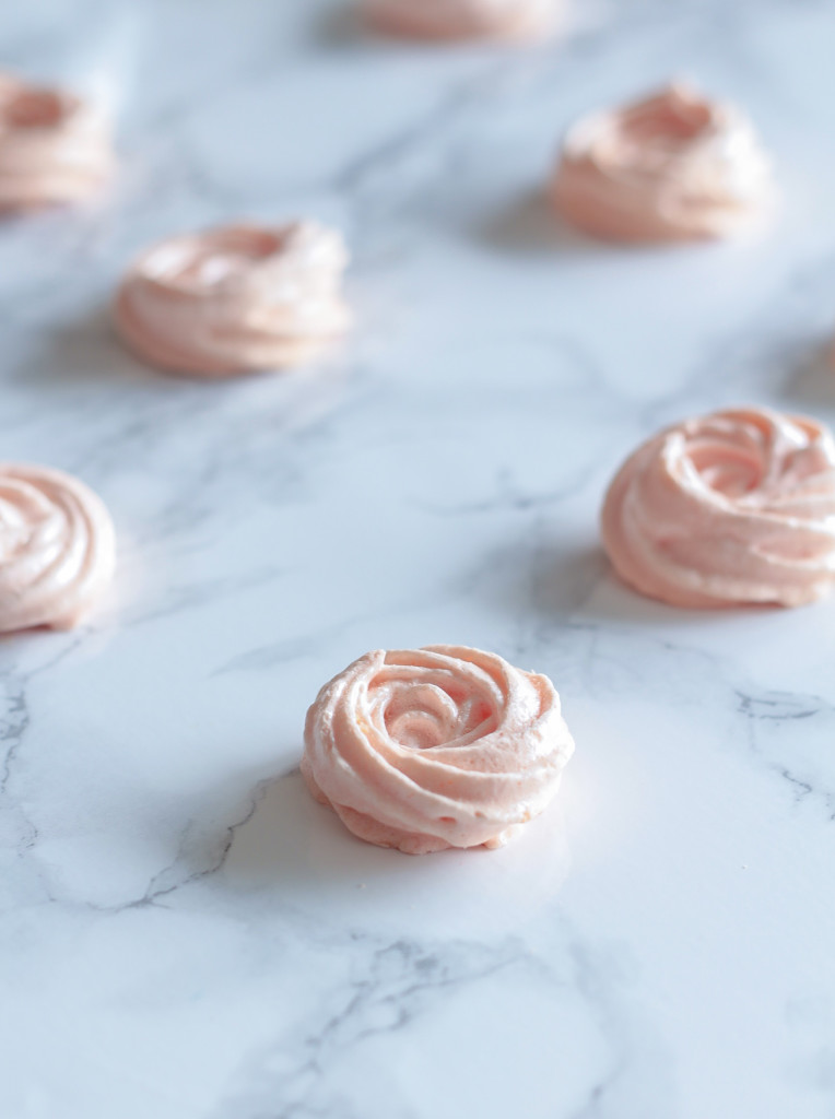 small Rose Meringue cookies arranged on a marble kitchen countertop