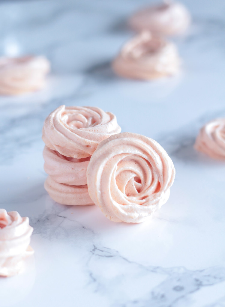 pastel pink Rose Meringues on a marble countertop