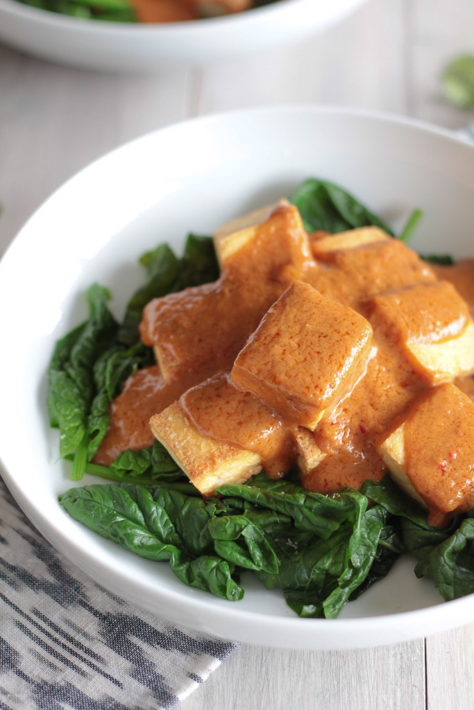 Tofu with Peanut Sauce on a bed of spinach