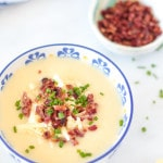 Loaded Baked Potato Cauliflower Soup in a small white bowl