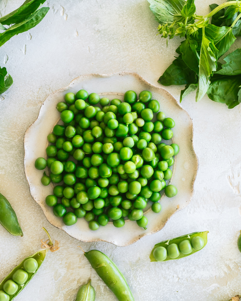 a plate of fresh shelled peas