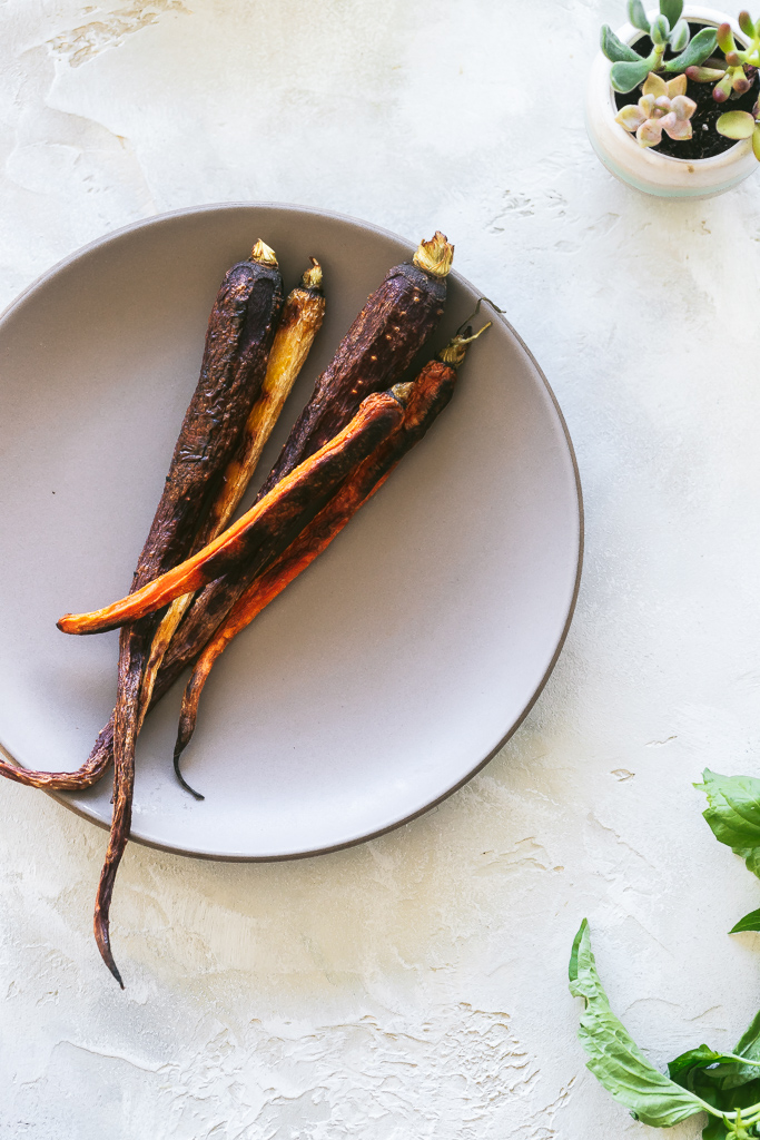 a plate of roasted rainbow carrots