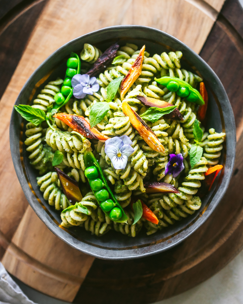 a bowl of pea pesto rotini in a grey ceramic bowl