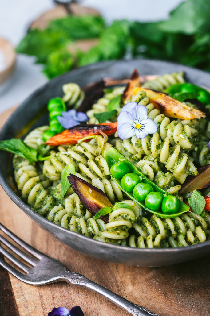 pea pesto pasta with roasted carrots, snap peas and edible flowers