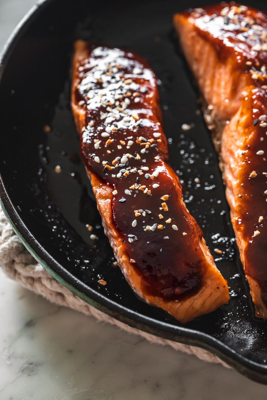 salmon with hoisin glaze in a skillet