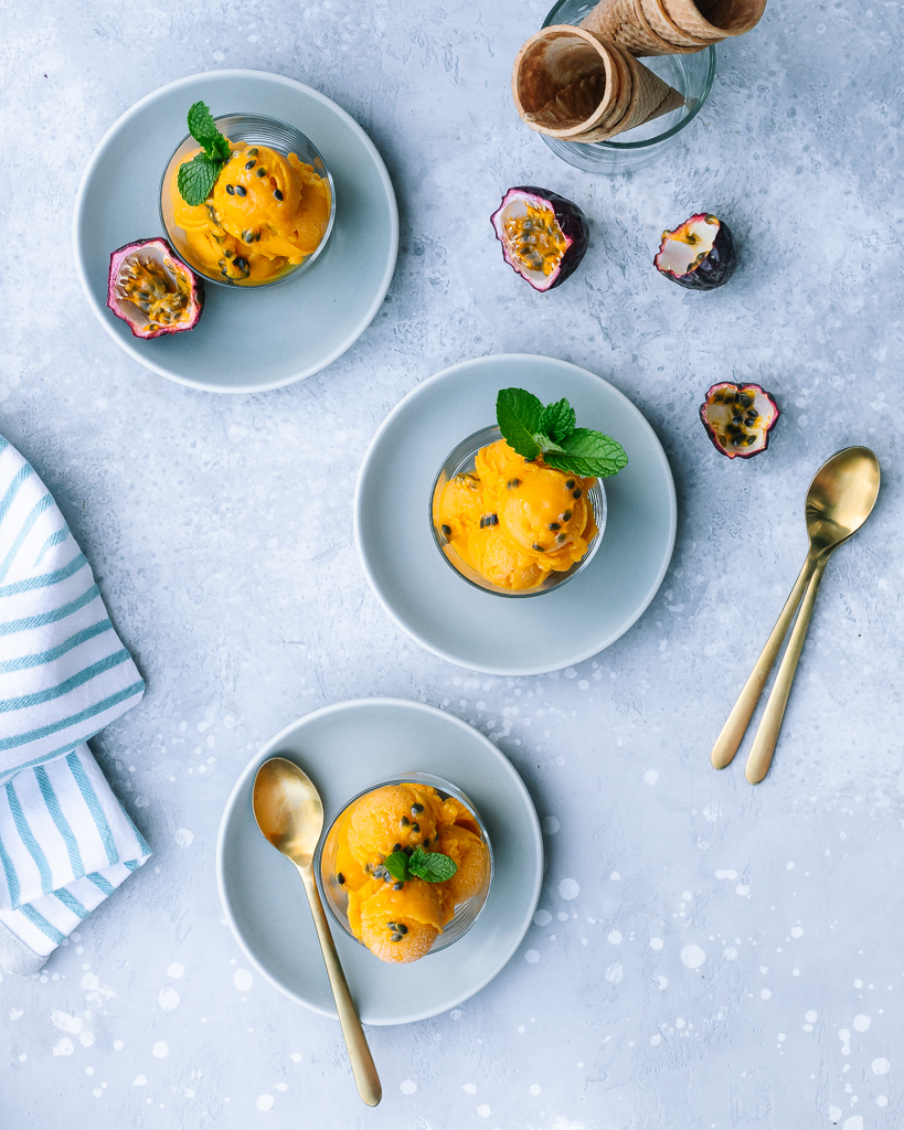 Scoops of Mango Passion Fruit Sorbet with fresh mint and passion fruit