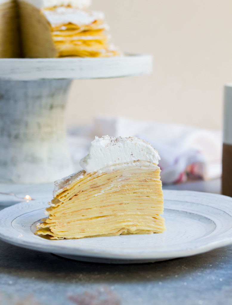 close-up of a slice of Eggnog Crepe Cake on a white plate