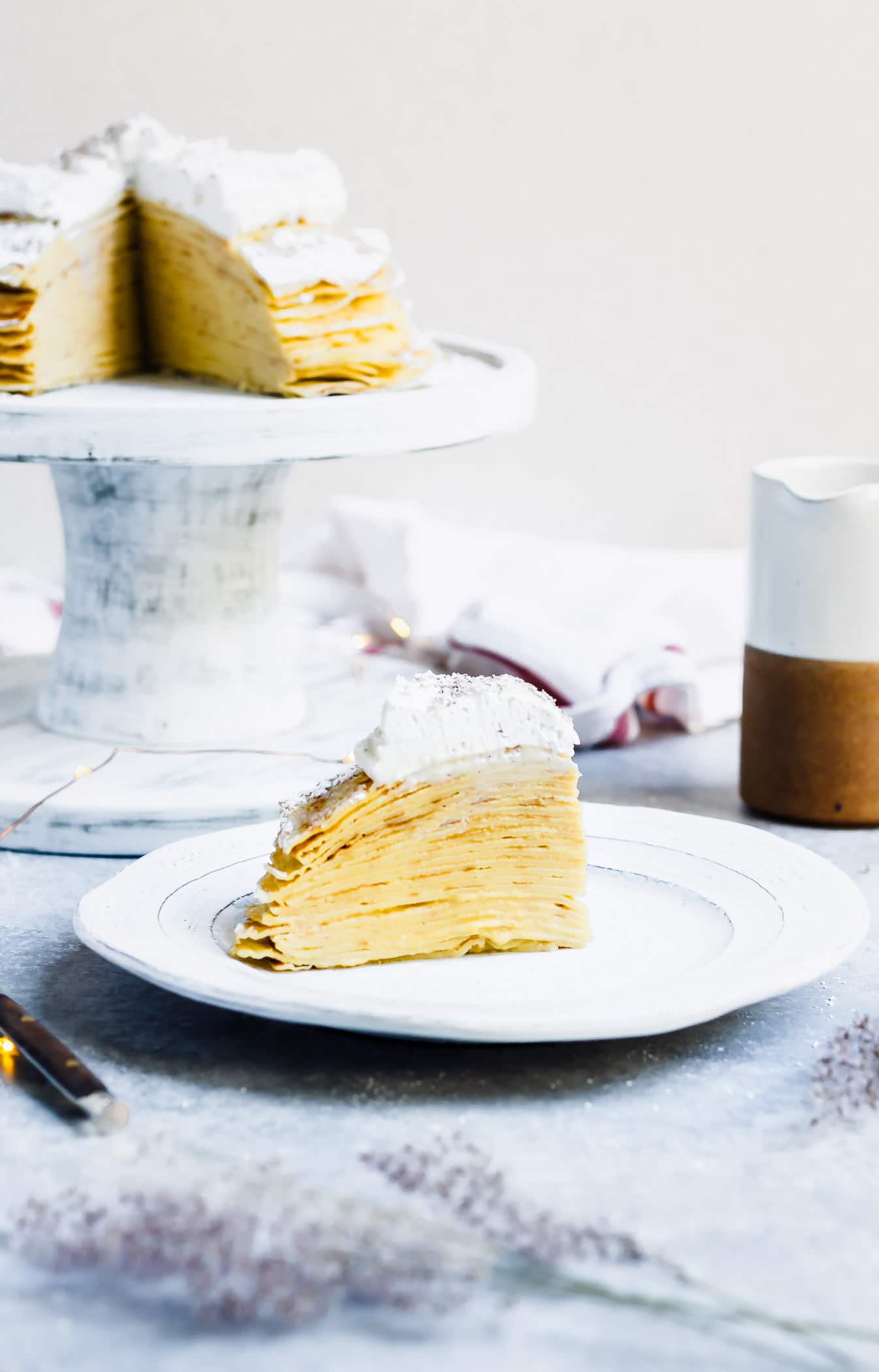 easy eggnog crepe cake with eggnog pastry cream sliced