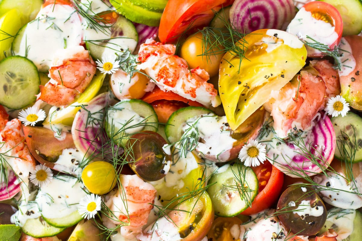 close-up of Heirloom Tomato Lobster Salad drizzled with buttermilk dill dressing
