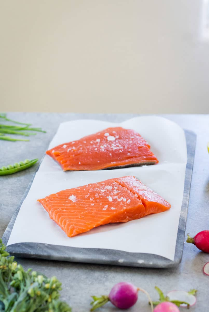 salted raw Alaska Salmon Fillets on kitchen counter ready for roasting
