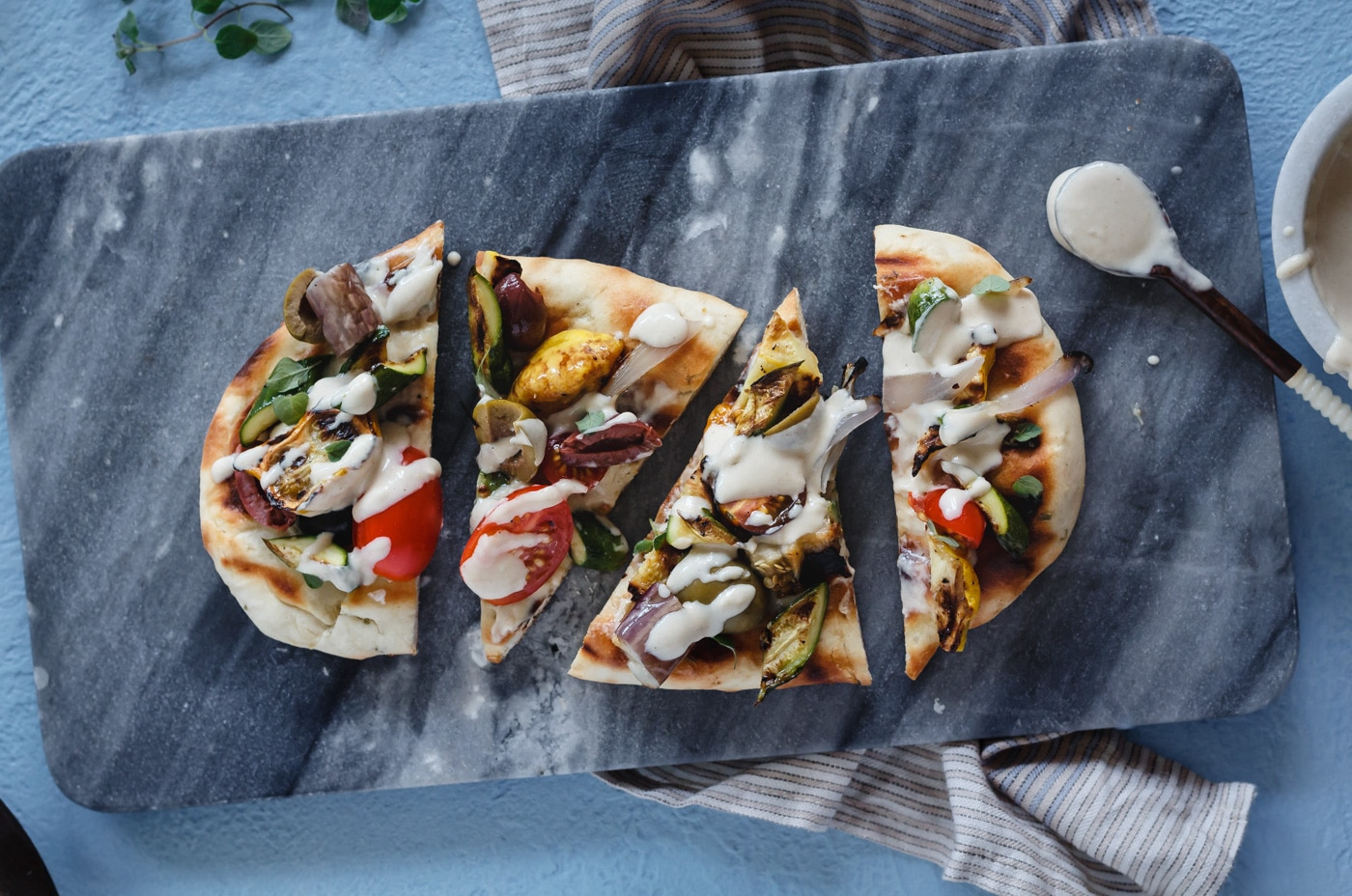 Mediterranean Grilled Flatbread Pizza cut into four slices