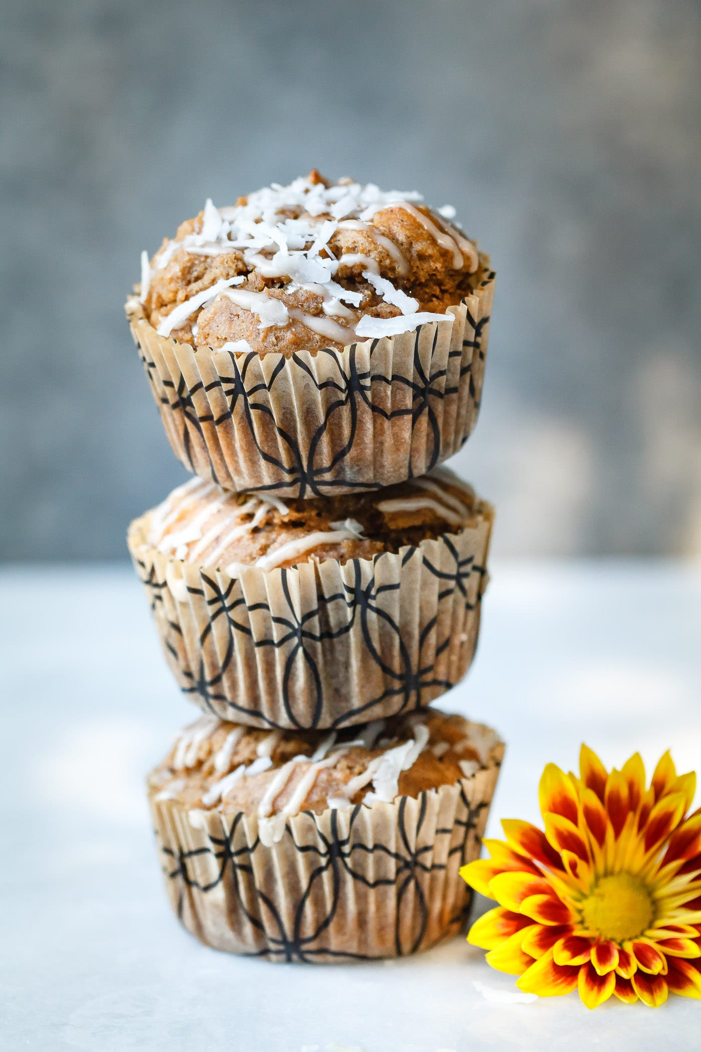 three vertically stacked Sweet Potato Coconut Chai Muffins