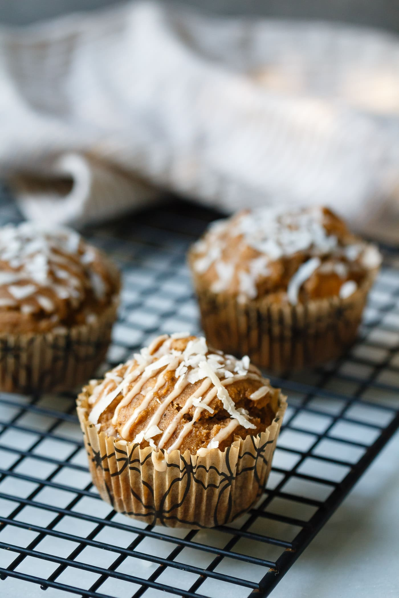 Sweet Potato Coconut Chai Muffins on a cooling rack