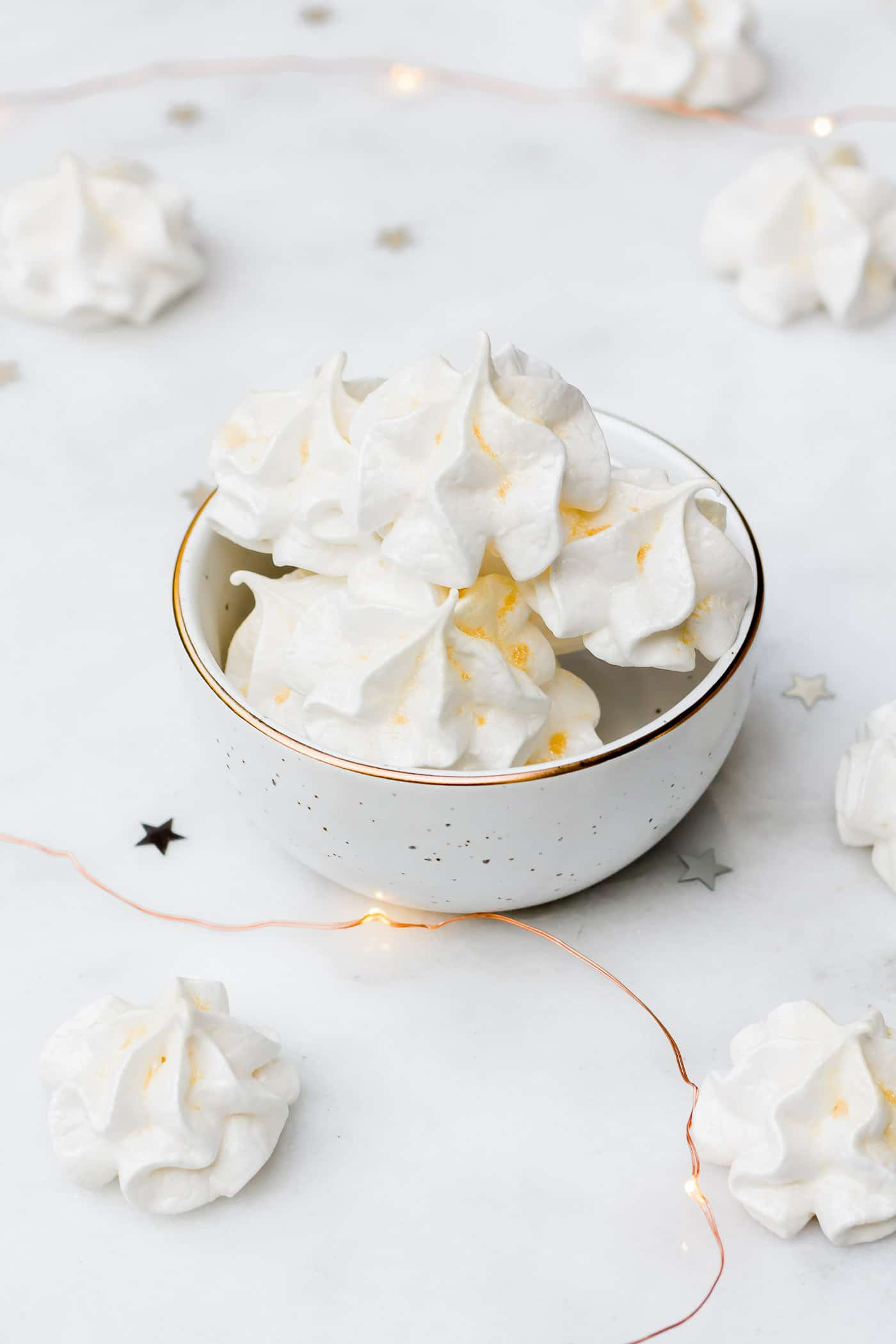 Champagne meringues in a white bowl