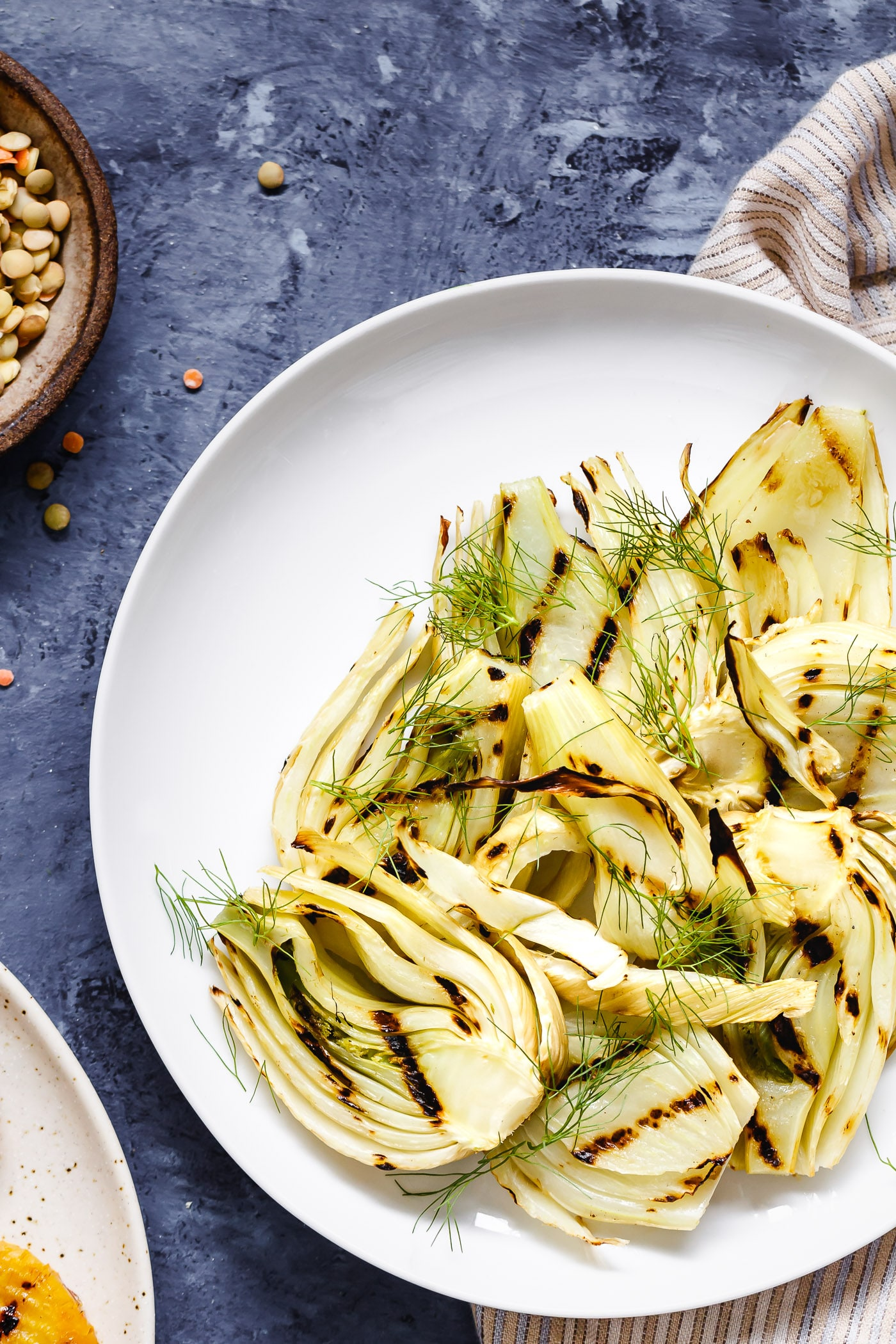 grilled slices of fennel on a white plate