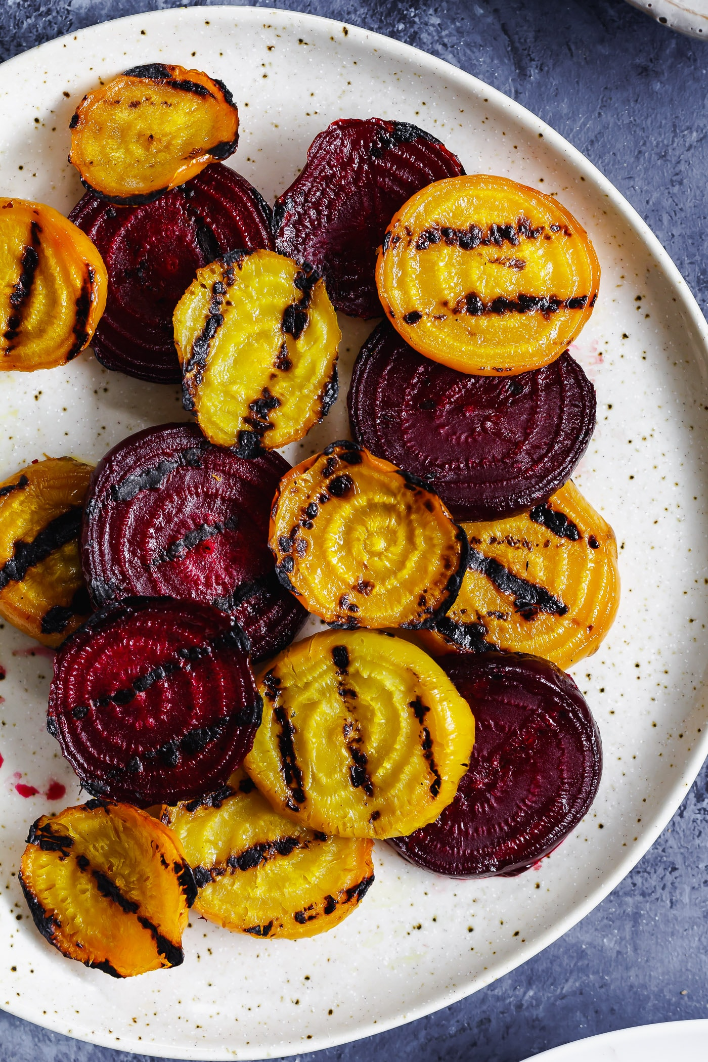 close up of grilled beets on a plate