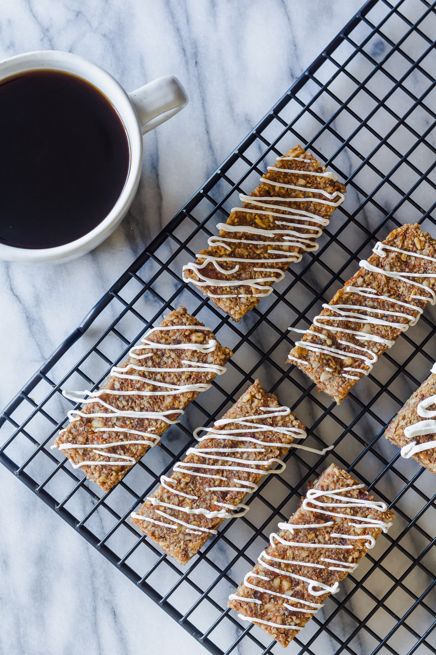 Carrot Cake Breakfast Bars on cooling rack with maple coconut icing
