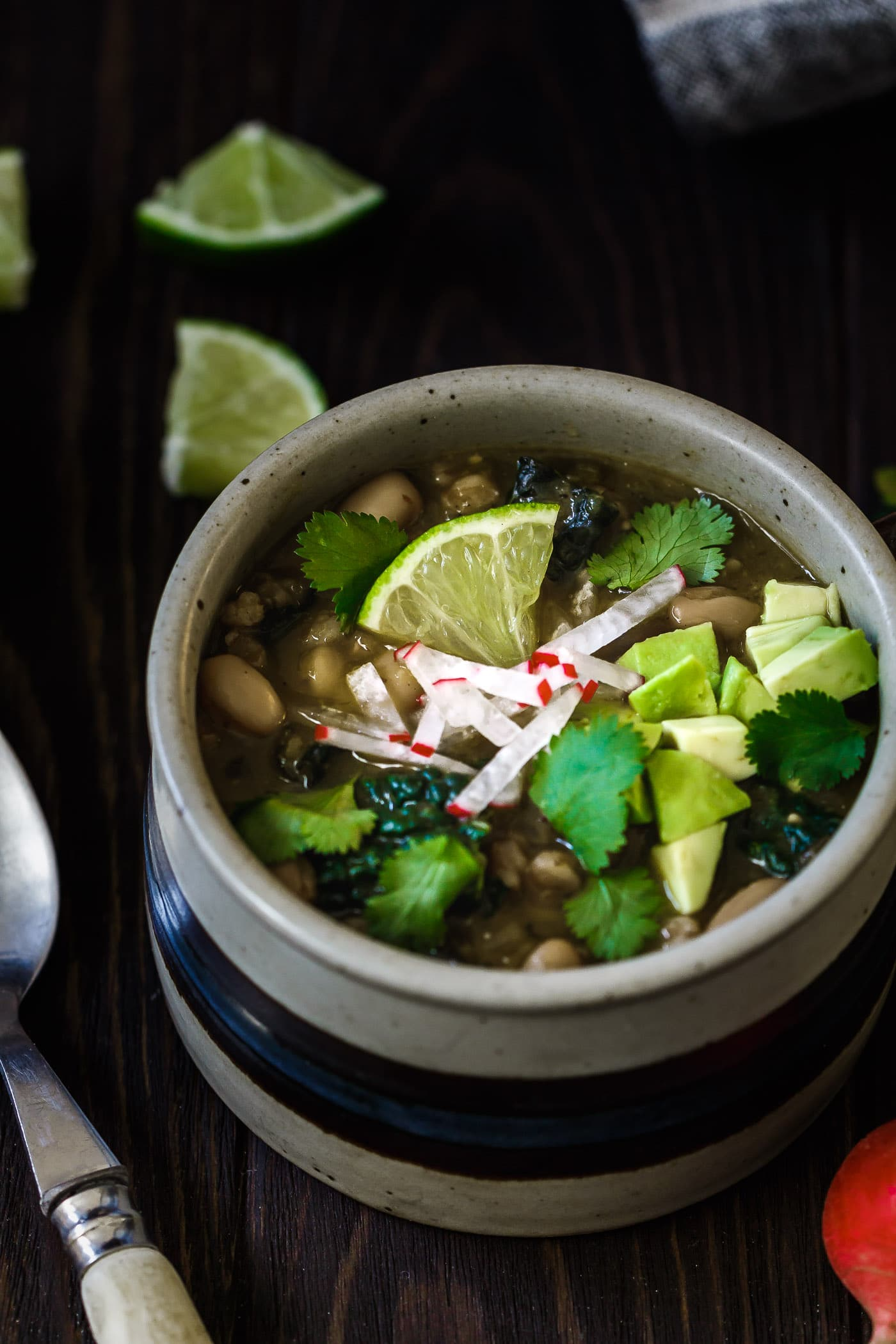 close up of Farro and White Bean Posole Verde in a soup mug