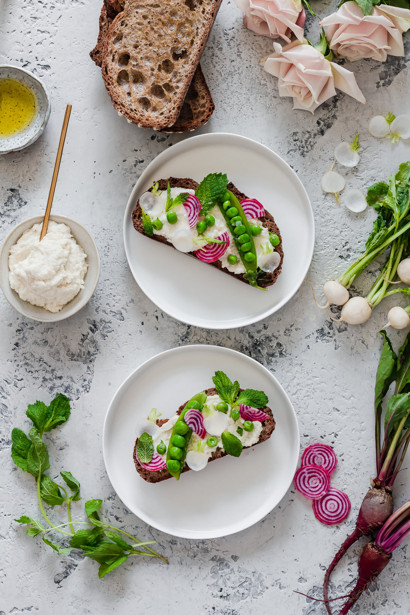 overhead shot of Vegan Spring Vegetable Crostini with macadamia ricotta