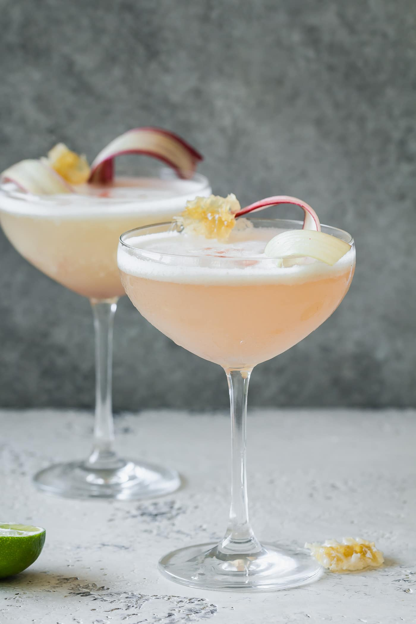 two glasses of Rhubarb Honey Pisco Sour - side view
