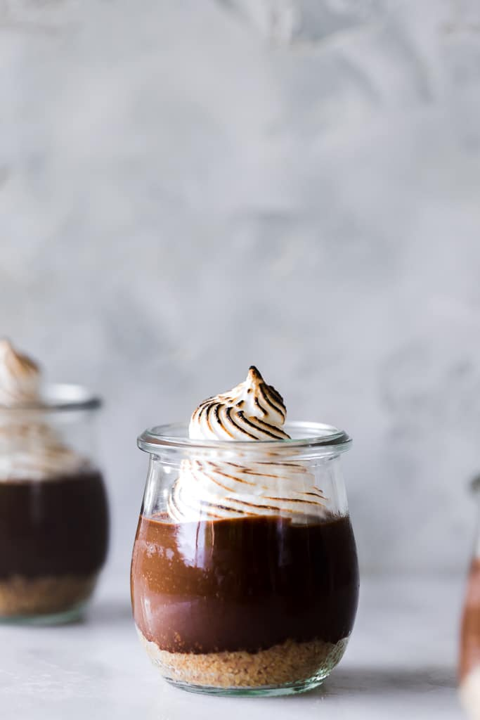homemade S'mores Parfaits with marshmallow fluff in small mason jars