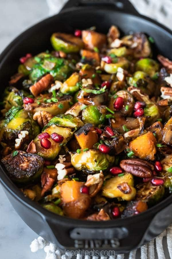 Brussels Sprout Hash studded with squash, pecans and pomegranate seeds and paired with a maple miso glaze! An easy healthy side dish for your holiday table. #sidedish, #christmasdinner