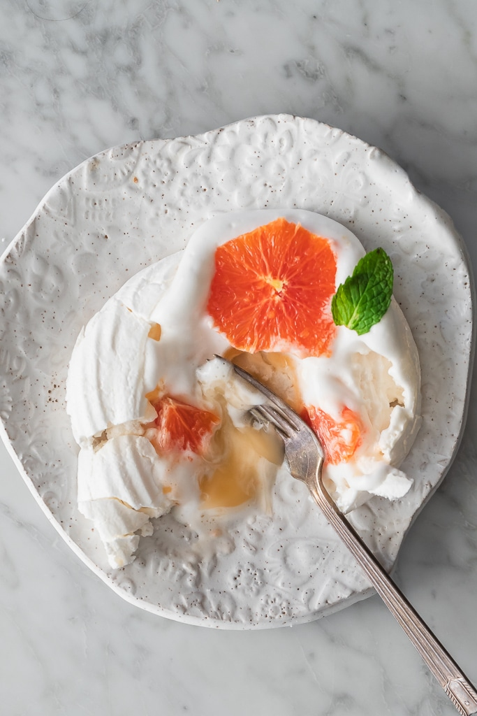 Vegan Pavlova with grapefruit curd eaten