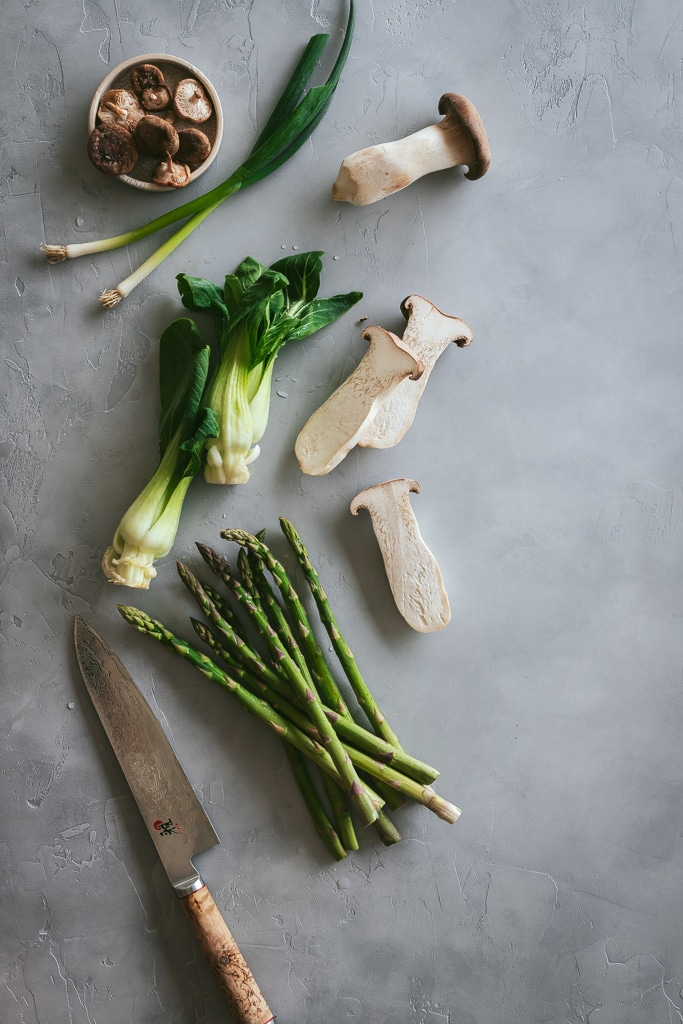 Sliced mushrooms, asparagus, bok choy and scallions