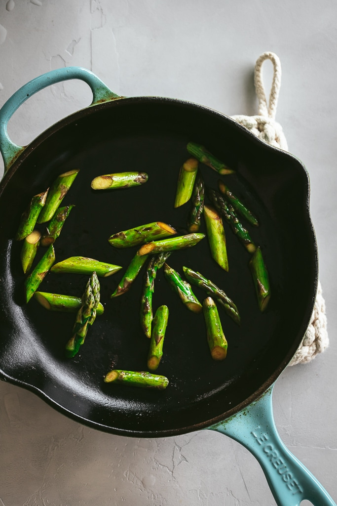 sauteed asparagus in a cast iron skillet