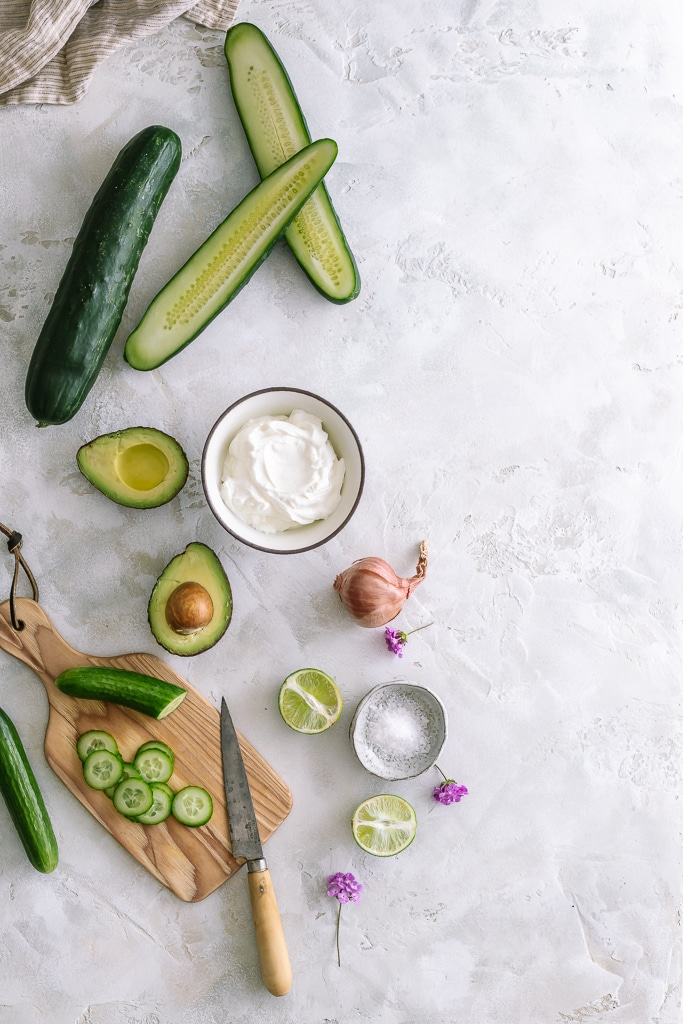 sliced cucumbers, shallots, avocado and limes for cucumber gazpacho