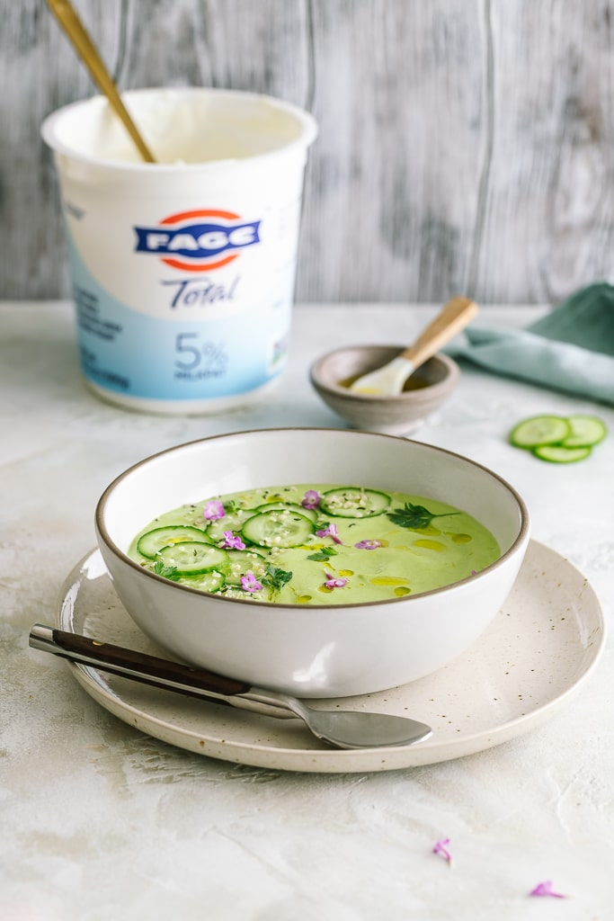 Bowl of cucumber gazpacho with sliced cucumbers on top