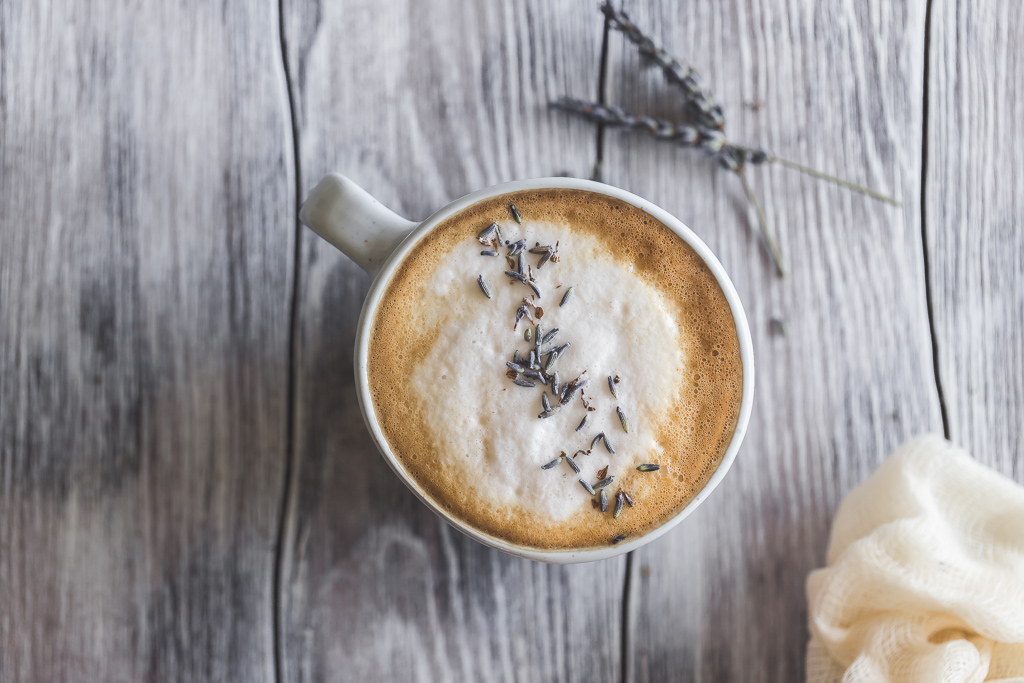 Lavender Latte with foam and dried lavender buds