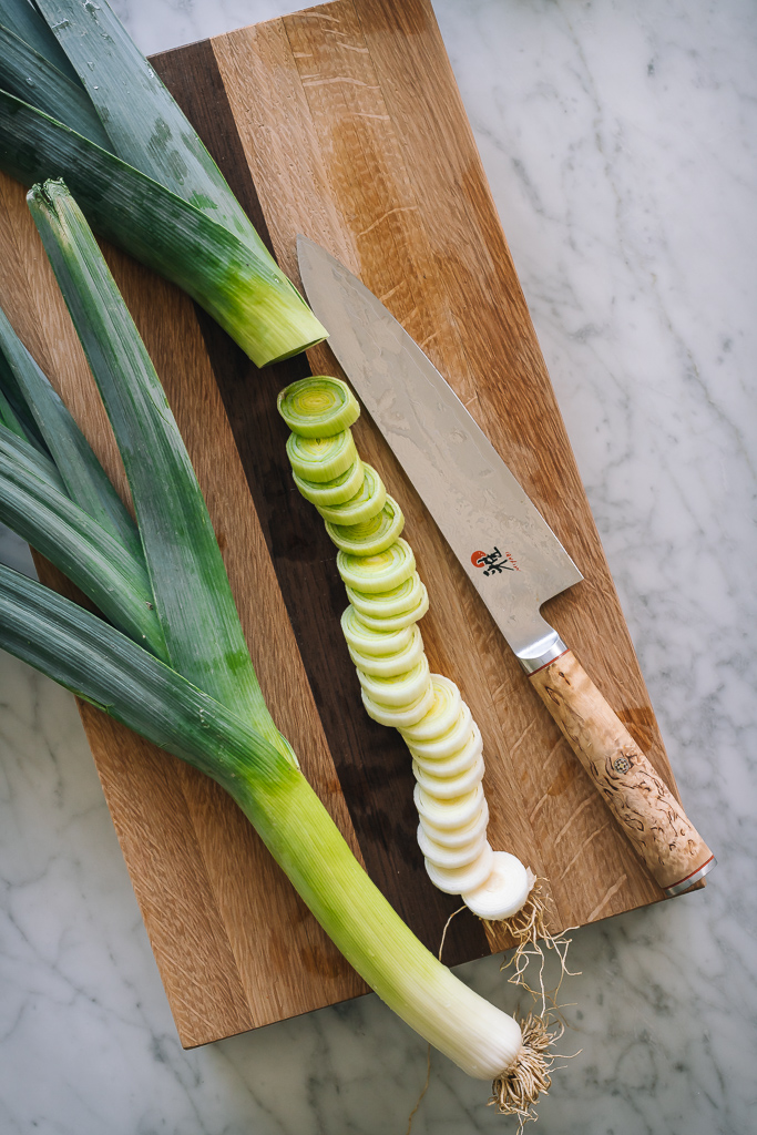 sliced leeks on a cutting board
