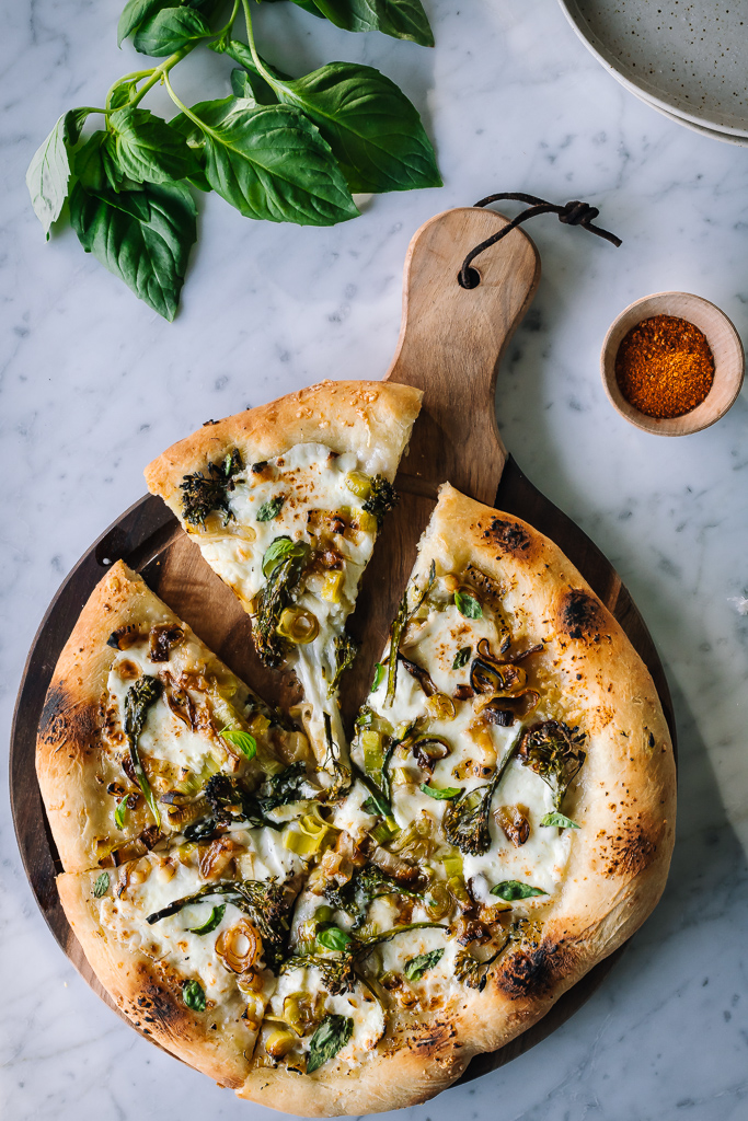 sliced broccolini and leek pizza
