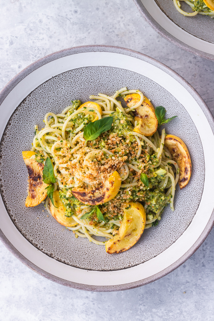 Spaghetti with green olive pesto, yellow squash and toasted breadrumbs