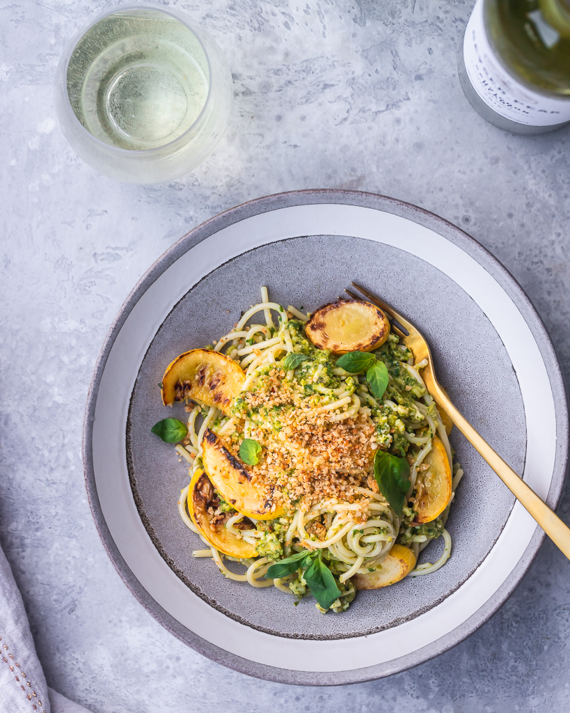Spaghetti with green olive pesto and yellow squash