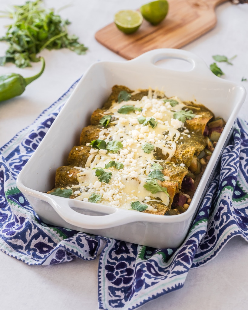 Hatch Green Chile Enchiladas in a white casserole dish
