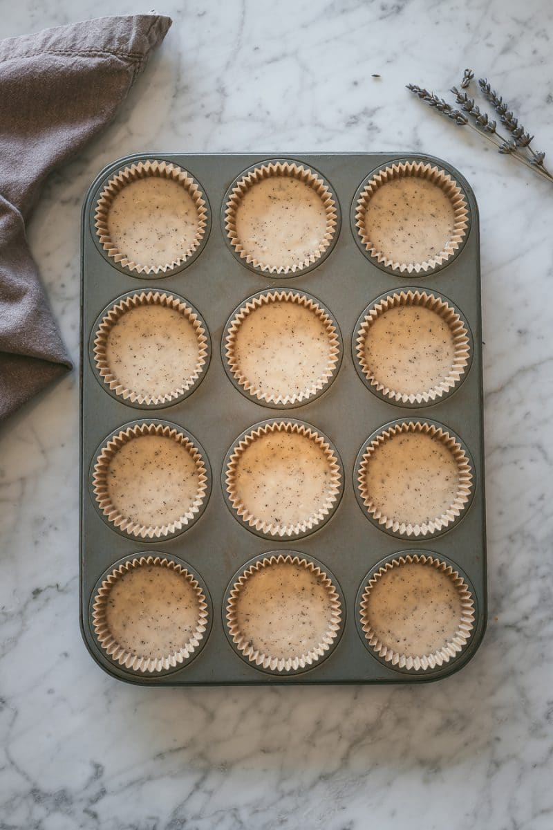 unbaked vegan earl grey cupcake batter in a muffin tin
