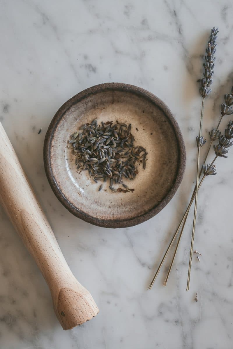 dried lavender in a bowl and a muddler