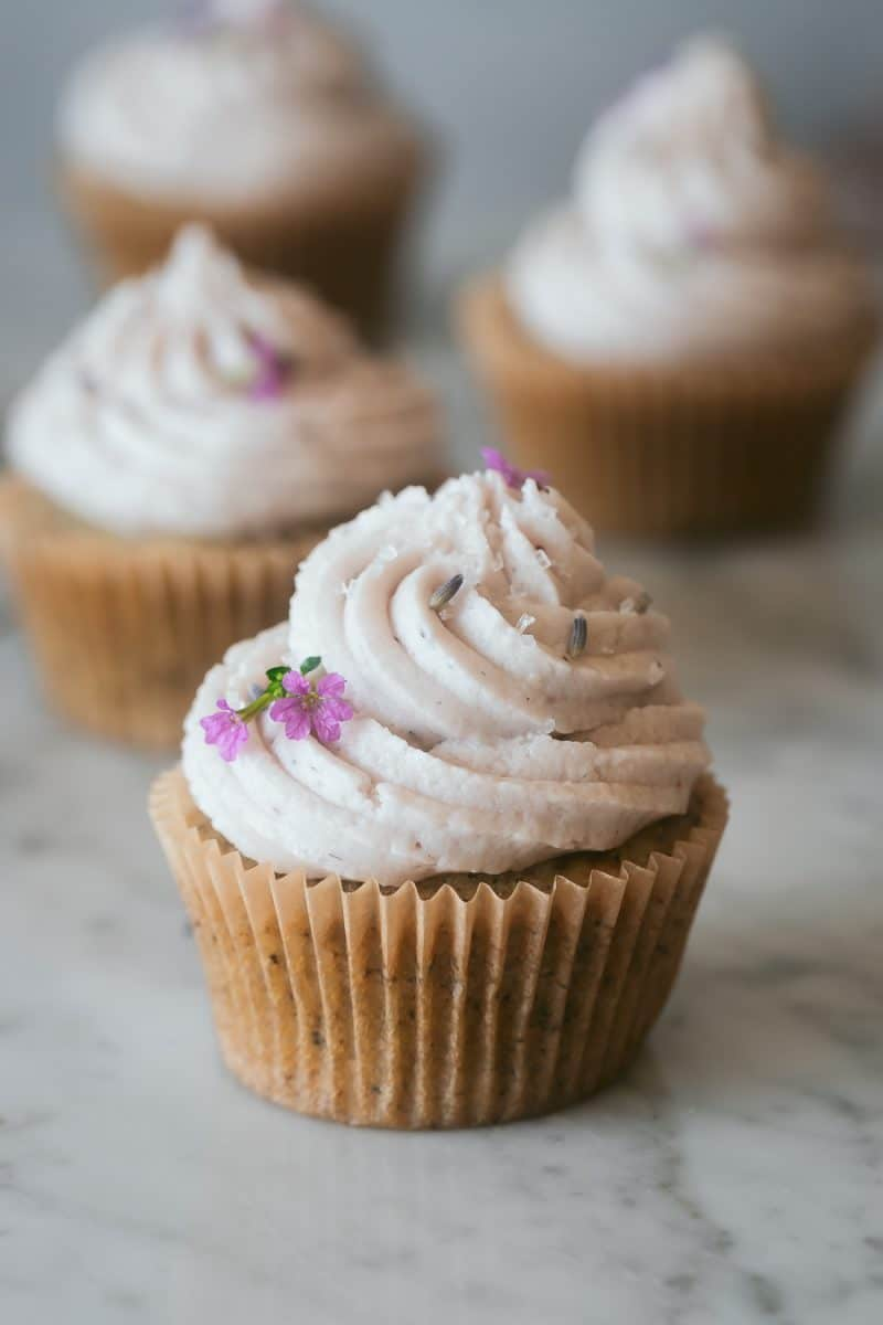 a vegan earl grey cupcake on a marble surface