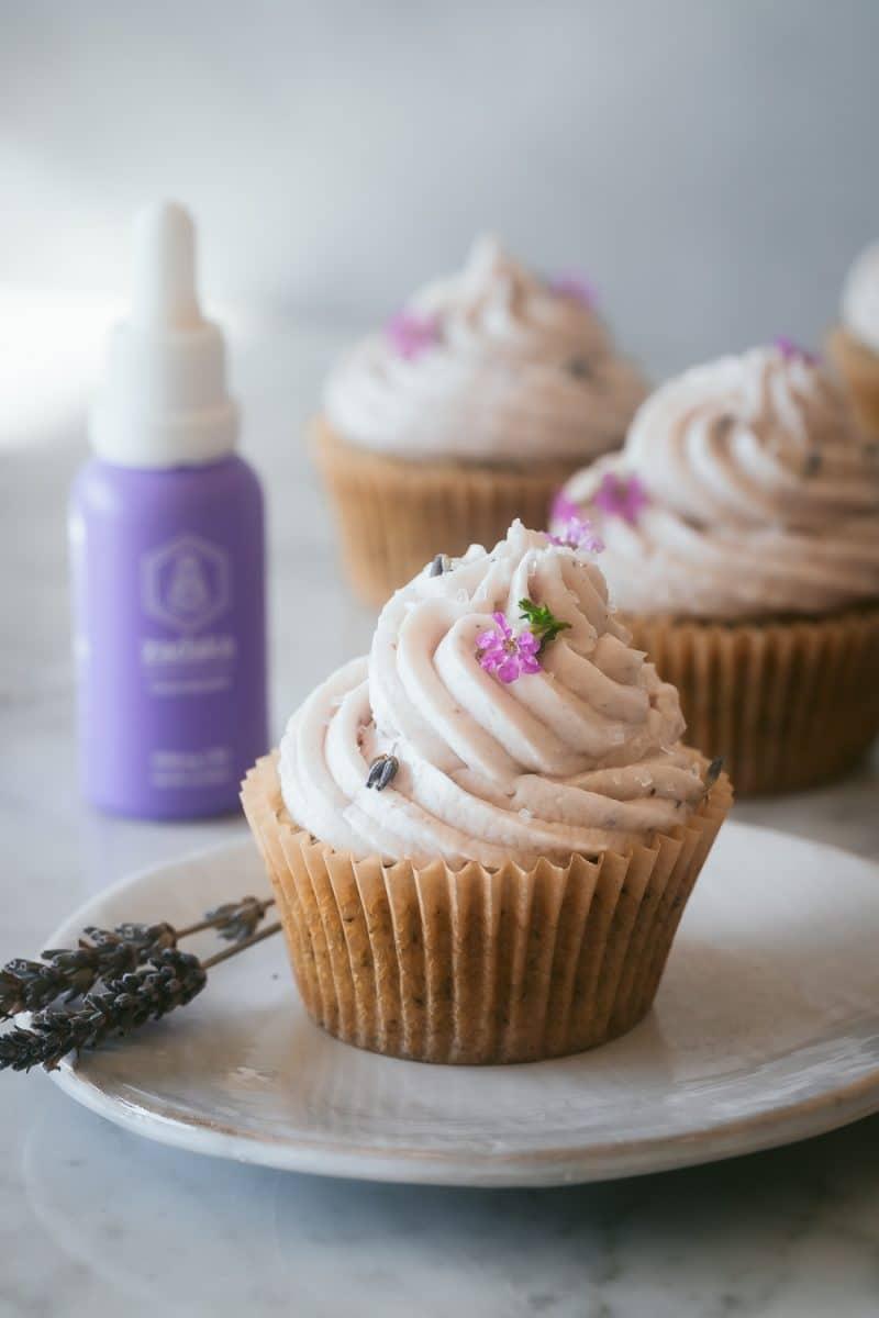 a vegan earl grey cupcake on a white plate