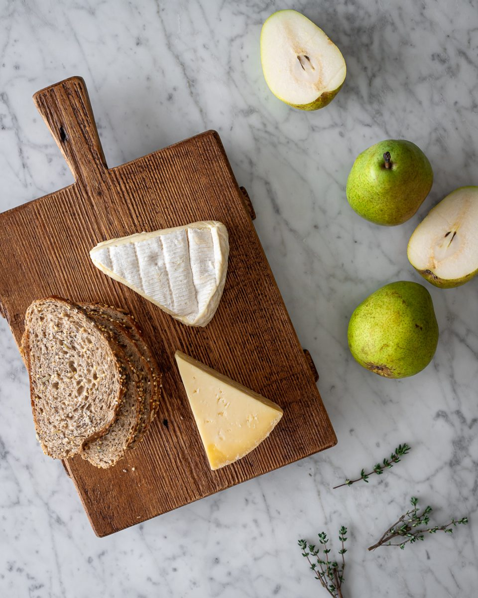 Brie, Gruyere, pears, fresh thyme and slices of wheat bread