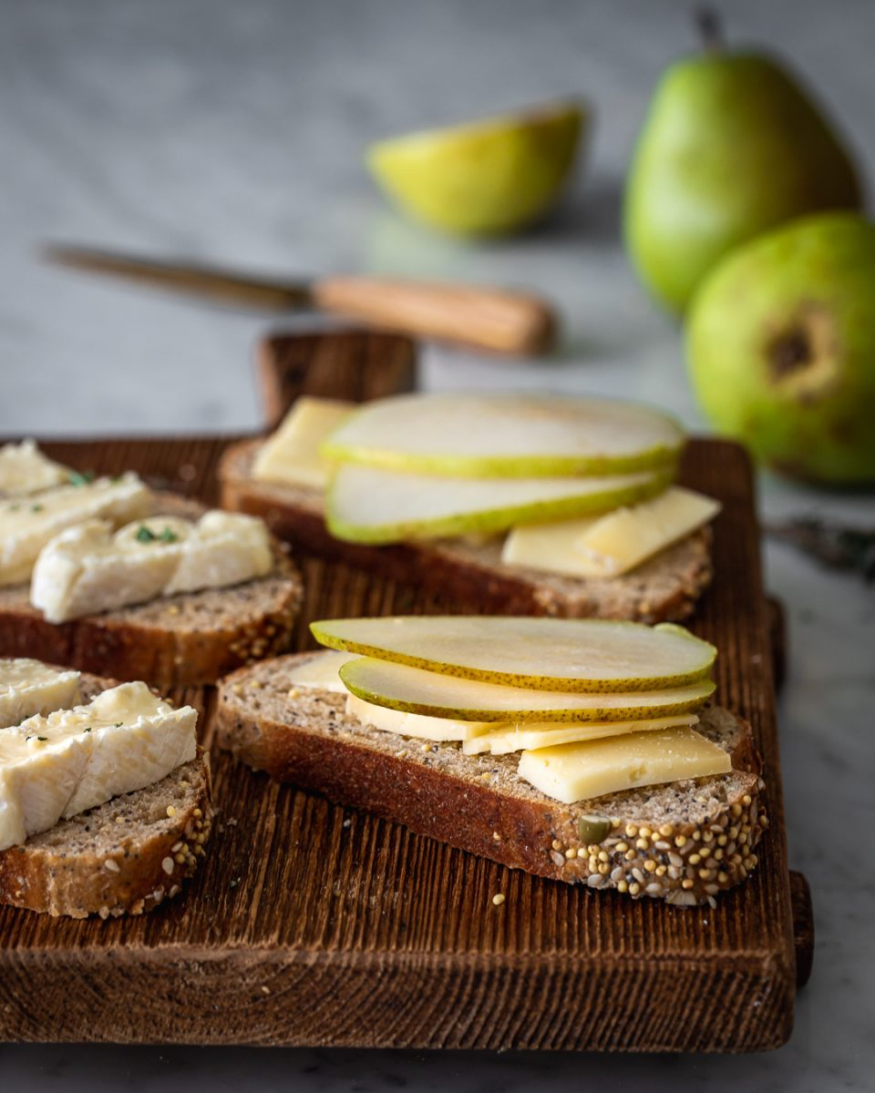 Brie and pear grilled cheese sandwiches being prepared